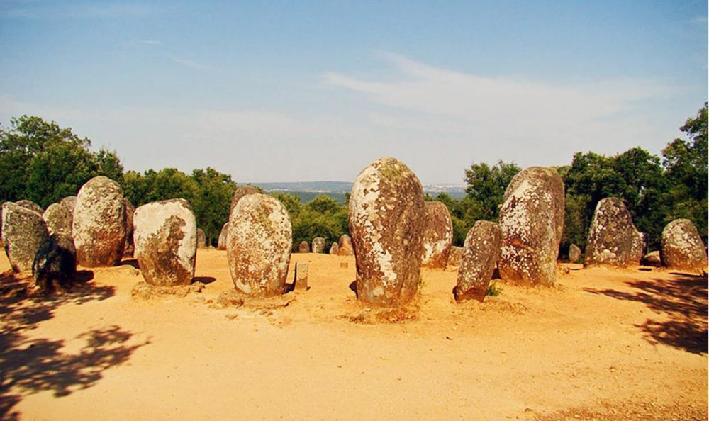 Featured image: Almendres Cromlech, Guadalupe, Evora, Portugal. (Wikimedia Commons)